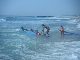 Surfers-in-training hit the ocean