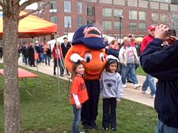 Otto with children on the SU Quad