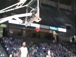 Houston County forward Desmond Warren dunks in transition