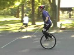 Unicycle polo rides around Alberta Park