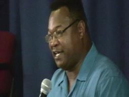 Ex-boxing champ Larry Holmes talks to kids at School 14 in Jersey City