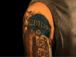 Adam wilson uses arm tattoo of cleveland landmarks to show for Cleveland skyline tattoo