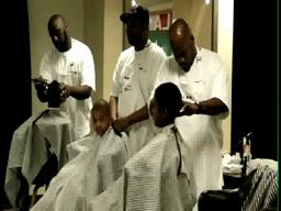 Volunteer barbers give kids free haircuts
