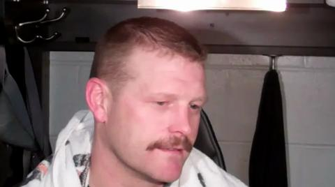 Bruins goalie Tim Thomas reacts to loss against Flyers