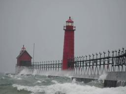 Surfer jumps off Grand Haven pier into waves during windstorm
