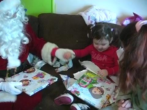 Santa and Syracuse firefighters visit a girl they helped before