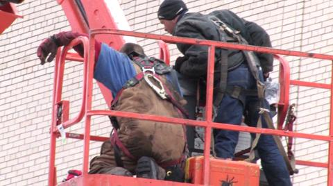 Worker Rescued from Atop Landmark Theatre