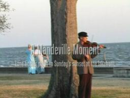 Lone fiddler plays to Mandeville sunset