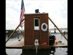 Friends float homemade houseboat down the Willamette