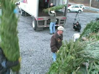 Local Christmas tree farmers donate 92 trees for the Trees for Troops program.