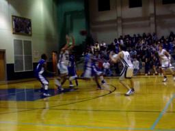 Gulf Shores' Ryan Godwin hits a 3-pointer against Escambia County