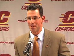Central Michigan coach Dan Enos thanks Spartans' Dantonio