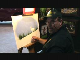 Wildlife artist paints at Eastern Sports and Outdoor Show