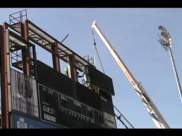 Scoreboard at Commerce Bank Park comes down