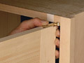 Learn how to make a simple router template that makes installing beautiful offset knife hinges a breeze.