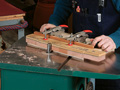 This ingenious router table jig keeps your fingers safe an offers smooth, trouble-free routing.