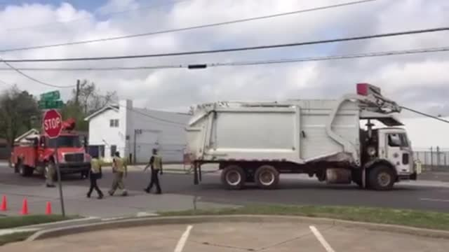 Man freed from trash truck entangled in power lines