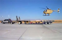 Unmanned H-6 Lands on a Moving Truck