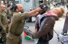 Israeli Soldier Strikes Activist with M-16