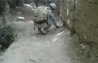US Soldier Picks Up a Wired IED!