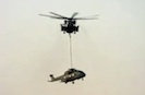 Marine Helo Carries Damaged RAF Helo