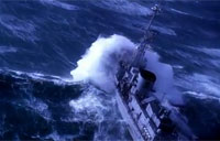 Warship Takes on Massive Waves