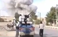 Syrian Rebels Almost Hit by Bomb