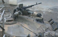 Rebels Fire AK-47 at SAA Tank Gun