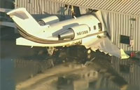 Passenger Jet Crashes Into Hangar