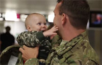Soldier Meets Baby at Hockey Game