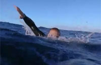 Navy SEAL Tharp Trains in Ocean