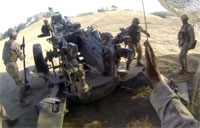 On the Gun Line with Howitzers