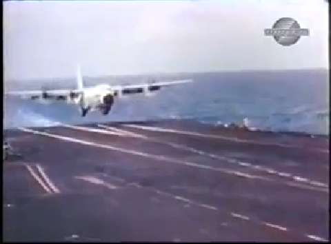 This C130 landing on an aircraft carrier will make you