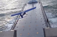 Small Plane Lands on Ship at Sea