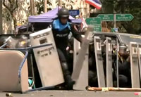 Thai Police Officer Kicks Grenade