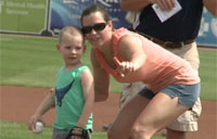 Airman Suprises Kids After First Pitch