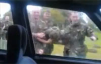 Soldier Goes Battering Ram on Car Window
