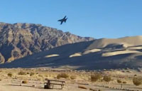 Jet Fighters Buzz Campers in the Desert