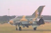 Mig-21s Takeoff, Land in Grass Field