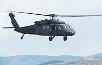 Black Hawk Flying Through Utah Canyon