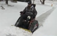 Veteran Plows Snow with Wheelchair