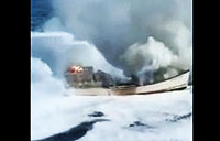 CG Cutter Extinguishes Fire on Fishing Boat